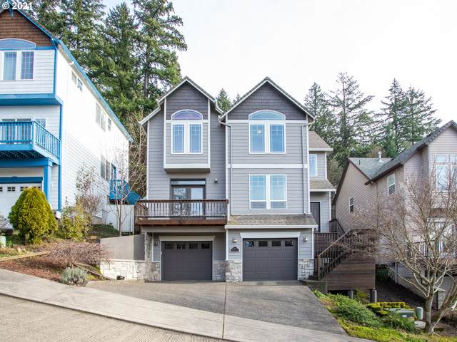 10212 SW 57TH Pl, Portland, OR 97219 (MLS #21564669) :: Townsend Jarvis Group Real Estate