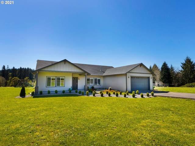 3830 Lewis River Rd, Woodland, WA 98674 (MLS #21572612) :: Premiere Property Group LLC