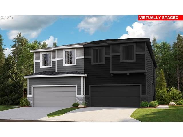 3126 N Pioneer Canyon Dr, Ridgefield, WA 98642 (MLS #21577574) :: McKillion Real Estate Group