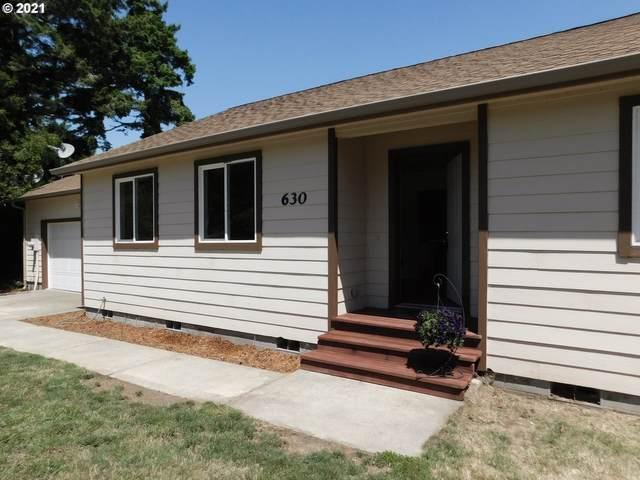 630 Eleventh St, Port Orford, OR 97465 (MLS #21583281) :: McKillion Real Estate Group
