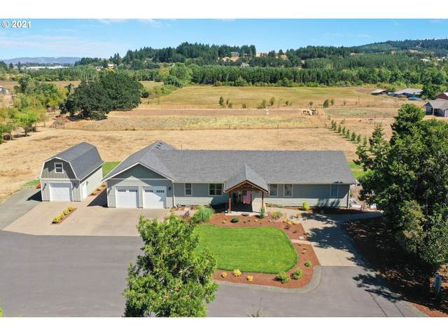 2020 SW Fairview Ave, Dallas, OR 97338 (MLS #21627988) :: McKillion Real Estate Group