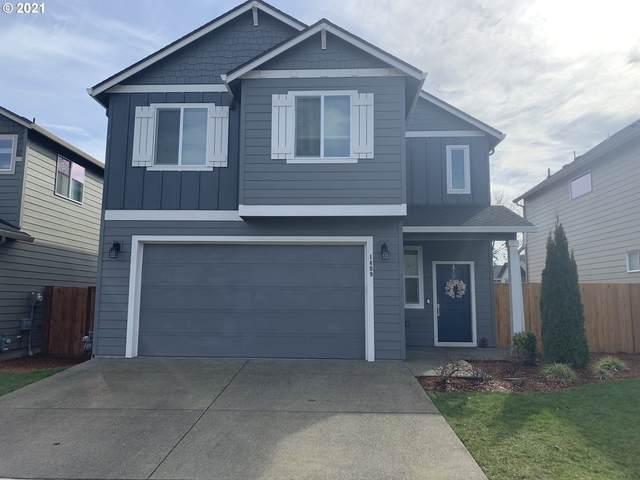 1409 NE 171ST St, Ridgefield, WA 98642 (MLS #21668991) :: Real Tour Property Group
