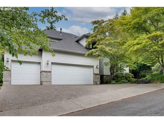 9715 NW Bartholomew Dr, Portland, OR 97229 (MLS #21680368) :: Real Tour Property Group