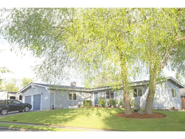 12827 SW 61ST Ave, Portland, OR 97219 (MLS #21697446) :: McKillion Real Estate Group