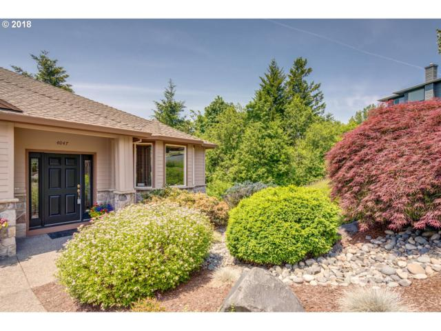 4047 NW Riggs Dr, Portland, OR 97229 (MLS #18069059) :: Cano Real Estate