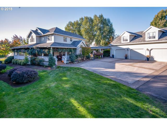 14664 SE Old Barn Ln, Damascus, OR 97089 (MLS #18136647) :: Hatch Homes Group
