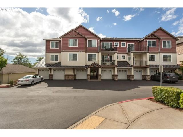 615 NW Lost Springs Ter #102, Portland, OR 97229 (MLS #18645640) :: McKillion Real Estate Group