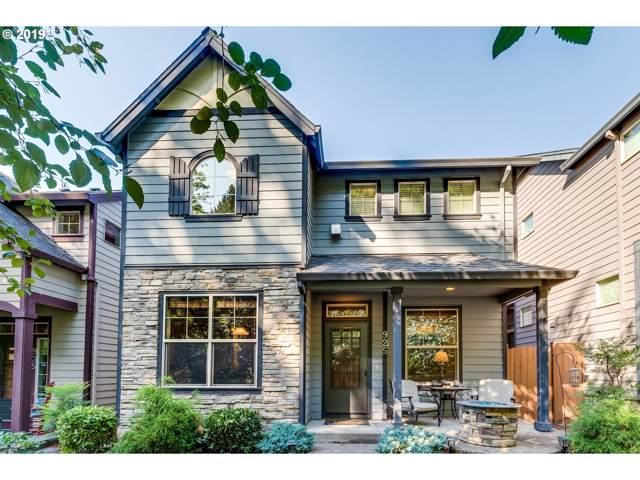925 SW Mozart Ter, Portland, OR 97225 (MLS #19494633) :: Townsend Jarvis Group Real Estate