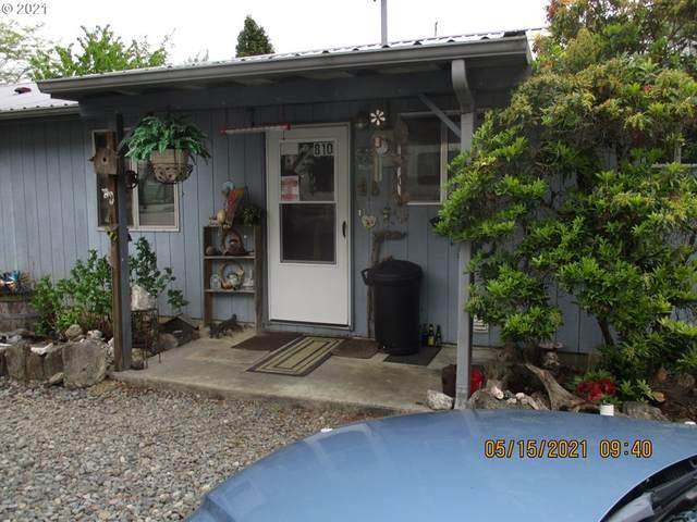 810 Myrtle Dr, Powers, OR 97466 (MLS #21430994) :: Beach Loop Realty