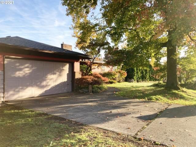 11711 NE Fremont St, Portland, OR 97220 (MLS #21523669) :: Song Real Estate