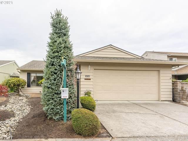 15730 SW Oakhill Ln, Tigard, OR 97224 (MLS #21570309) :: Holdhusen Real Estate Group