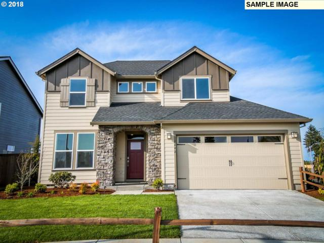 10703 SE Black Tail Rd, Happy Valley, OR 97086 (MLS #18049633) :: Team Zebrowski