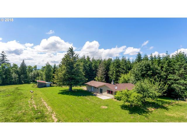 15025 NW Rock Creek Rd, Portland, OR 97231 (MLS #18409609) :: Hatch Homes Group
