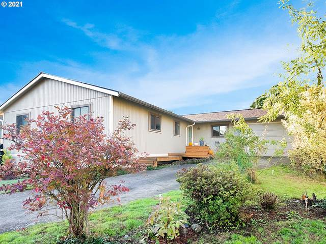 5012 NE Emerson Ct, Portland, OR 97218 (MLS #21244072) :: Real Estate by Wesley