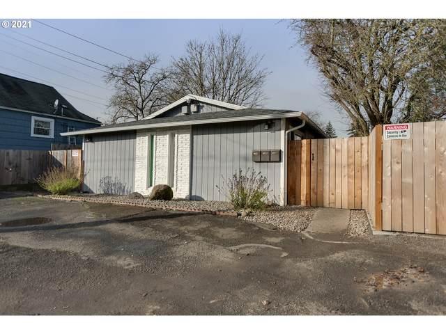9911 SE Woodstock Ct, Portland, OR 97266 (MLS #21430416) :: Duncan Real Estate Group