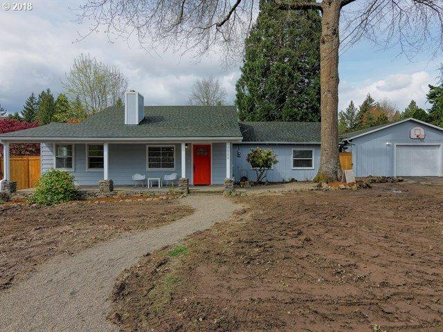 7555 SW Florence Ln, Tigard, OR 97223 (MLS #18422019) :: McKillion Real Estate Group