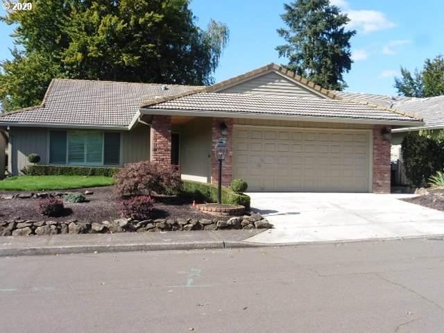 10075 SW Century Oak Dr, Tigard, OR 97224 (MLS #20512797) :: McKillion Real Estate Group