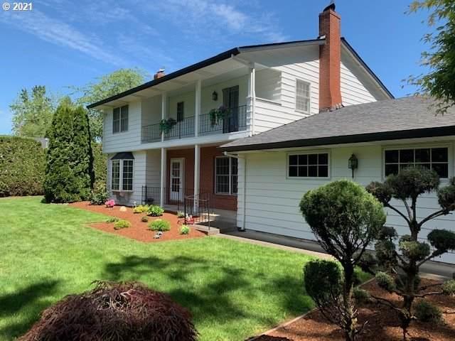14910 SE Woodland Way, Milwaukie, OR 97267 (MLS #21056771) :: The Haas Real Estate Team