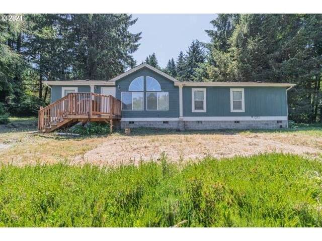 566 N Deerlane Dr, Otis, OR 97368 (MLS #21305416) :: Holdhusen Real Estate Group