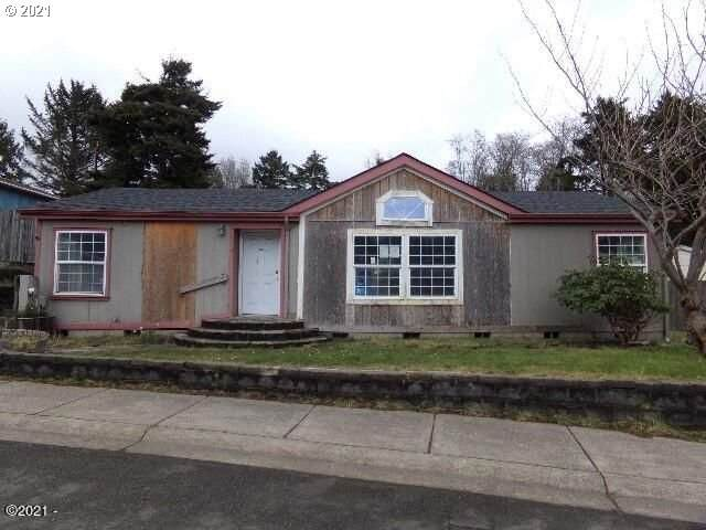 410 SE Neptune Ave, Lincoln City, OR 97367 (MLS #21479770) :: Song Real Estate