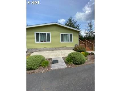 94131 Shutters Landing Ln, North Bend, OR 97459 (MLS #21529832) :: Fox Real Estate Group