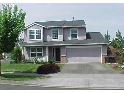 2197 SE 61ST Dr, Hillsboro, OR 97123 (MLS #21555246) :: McKillion Real Estate Group