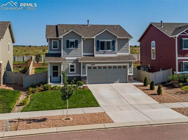 8884 Vanderwood Road, Colorado Springs, CO 80908 (#1011241) :: Springs Home Team @ Keller Williams Partners