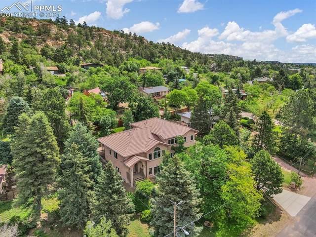 2765 N Chelton Road, Colorado Springs, CO 80909 (#1011881) :: Action Team Realty