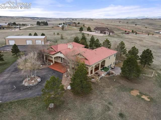 7070 Meadowpine Drive, Colorado Springs, CO 80908 (#1017842) :: The Daniels Team
