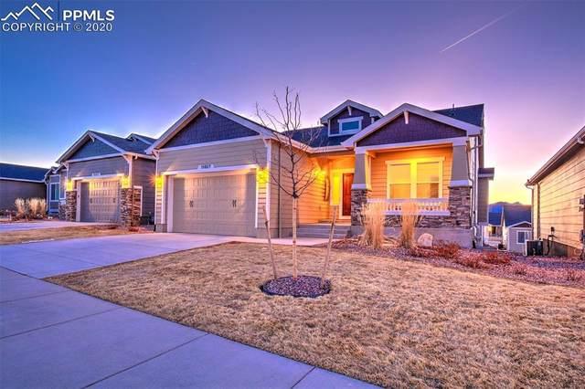 10827 Hidden Brook Circle, Colorado Springs, CO 80908 (#1039679) :: The Daniels Team