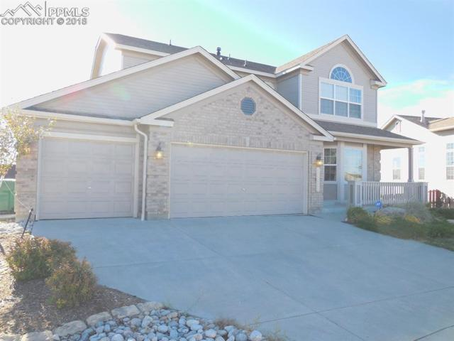12427 Ellingwood Peak Place, Peyton, CO 80831 (#1075385) :: The Hunstiger Team