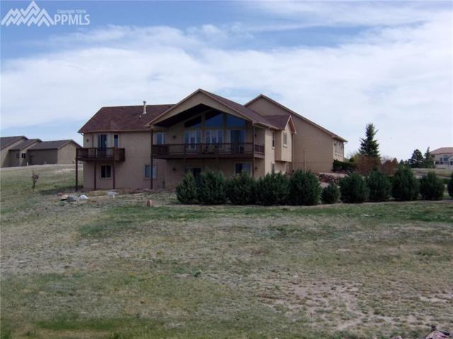 7060 Lakenheath Lane, Colorado Springs, CO 80908 (#1132364) :: The Peak Properties Group