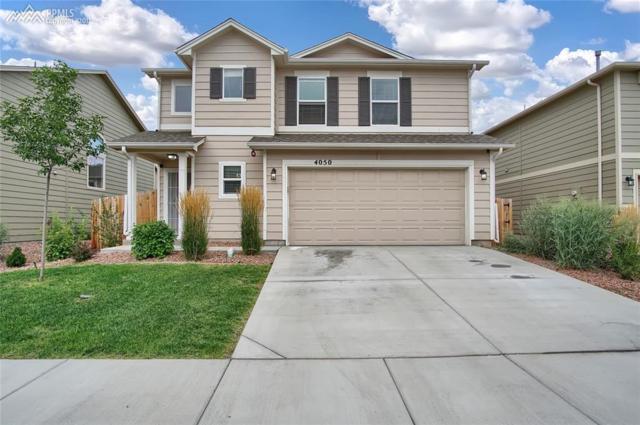 4050 Silver Star Grove, Colorado Springs, CO 80911 (#1149829) :: Action Team Realty