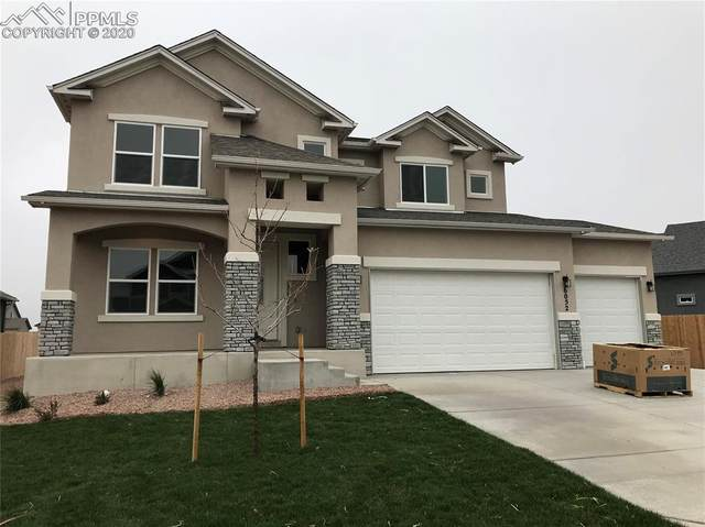 6052 Nash Drive, Colorado Springs, CO 80925 (#1199289) :: The Treasure Davis Team