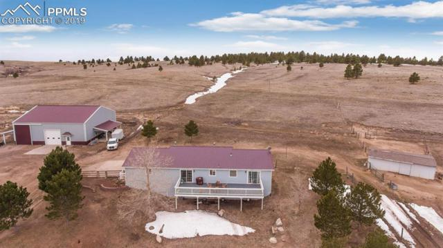 10326 County 110 Road, Elizabeth, CO 80117 (#1284661) :: Compass Colorado Realty