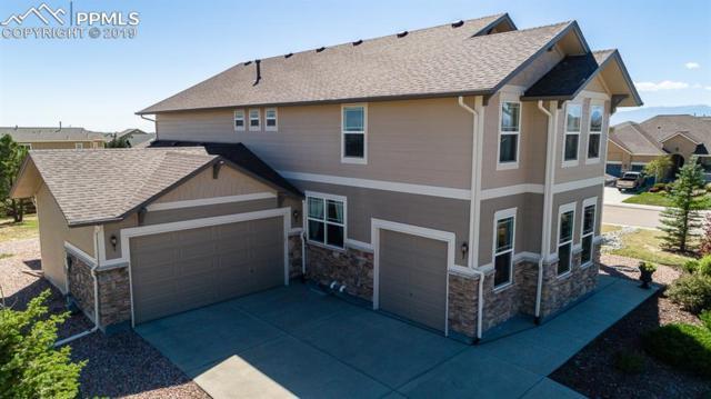 11205 Prairie Walk Terrace, Peyton, CO 80831 (#1304057) :: The Peak Properties Group