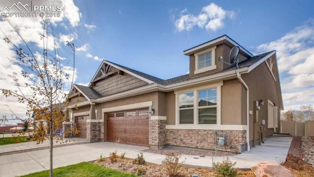 11415 Rill Point, Colorado Springs, CO 80908 (#1343607) :: The Hunstiger Team