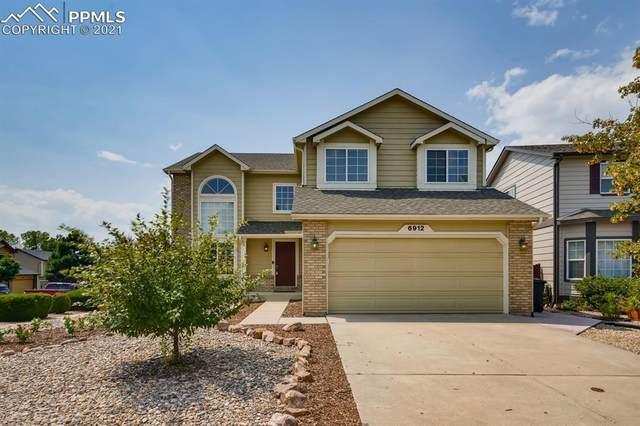 6912 Cloud Dancer Drive, Colorado Springs, CO 80923 (#1373900) :: Symbio Denver