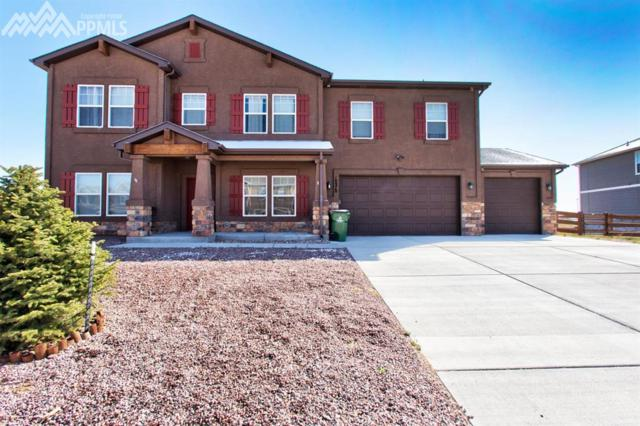 10978 Middlegate Court, Peyton, CO 80831 (#1410504) :: 8z Real Estate