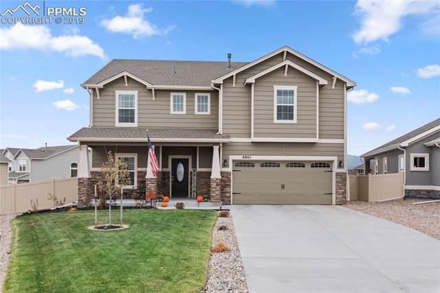 6861 Oak Vine Court, Colorado Springs, CO 80908 (#1412207) :: The Kibler Group