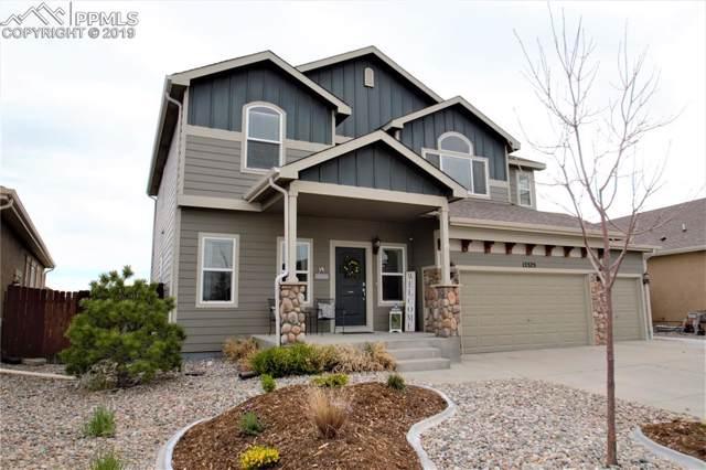 12375 Handles Peak Way, Peyton, CO 80831 (#1413829) :: Fisk Team, RE/MAX Properties, Inc.