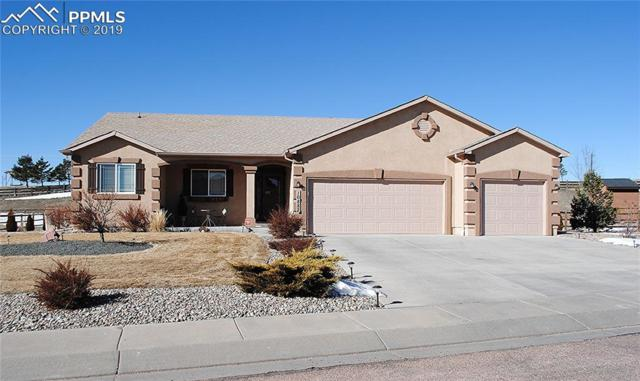 10882 Glen Canyon Drive, Peyton, CO 80831 (#1429020) :: The Hunstiger Team