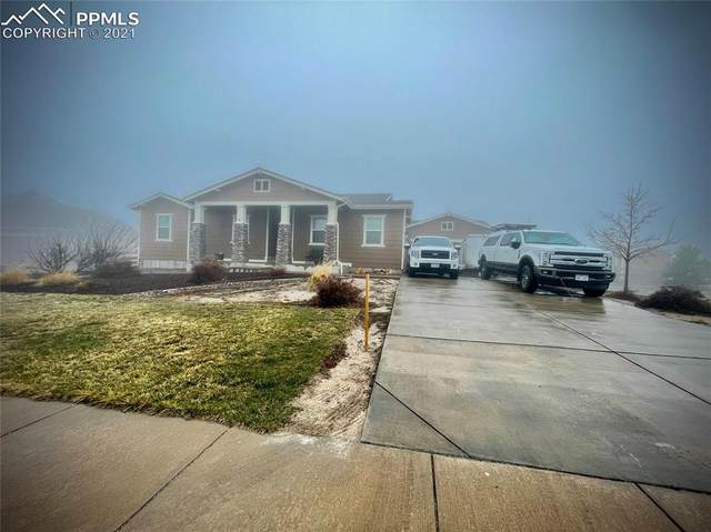 7032 Nulato Circle, Peyton, CO 80831 (#1473846) :: The Scott Futa Home Team