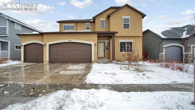 10215 Hidden Park Way, Peyton, CO 80831 (#1542909) :: The Treasure Davis Team