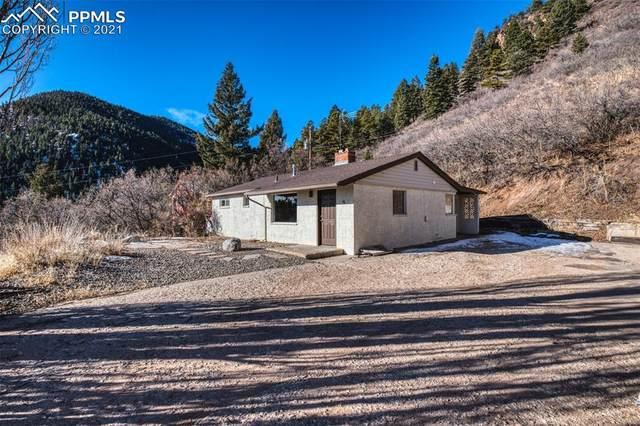 56 Highland Road, Palmer Lake, CO 80133 (#1564921) :: Finch & Gable Real Estate Co.
