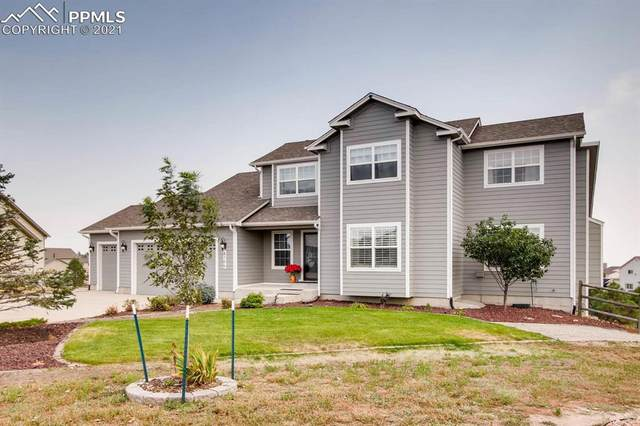 8705 Royal Lytham Court, Peyton, CO 80831 (#1578298) :: CC Signature Group