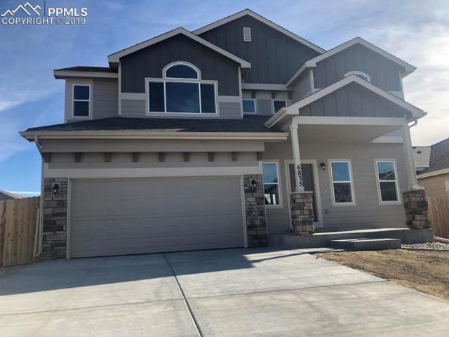 6835 Mandan Drive, Colorado Springs, CO 80925 (#1580021) :: The Hunstiger Team
