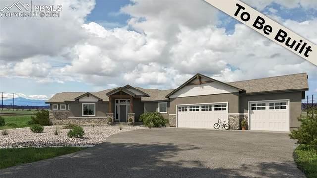 16638 Winsome Way, Colorado Springs, CO 80908 (#1655622) :: HomeSmart