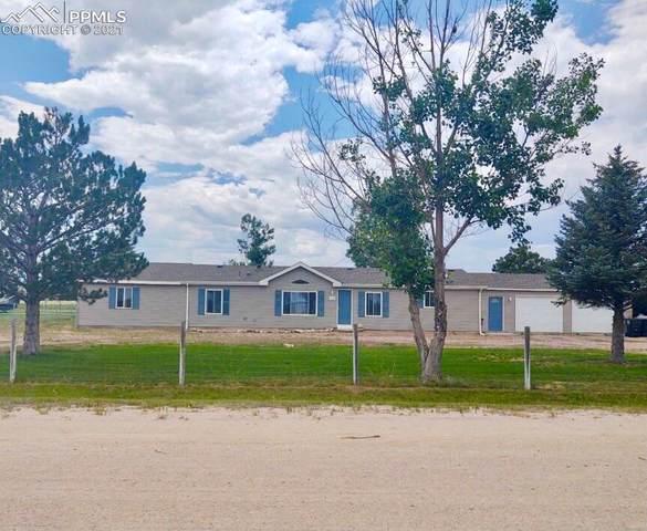 13360 Trail Boss Court, Peyton, CO 80831 (#1782751) :: Hudson Stonegate Team