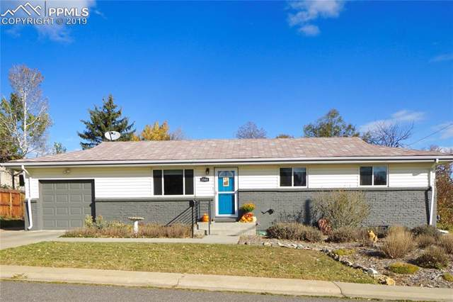 3385 W Tanforan Drive, Denver, CO 80110 (#1831807) :: Tommy Daly Home Team